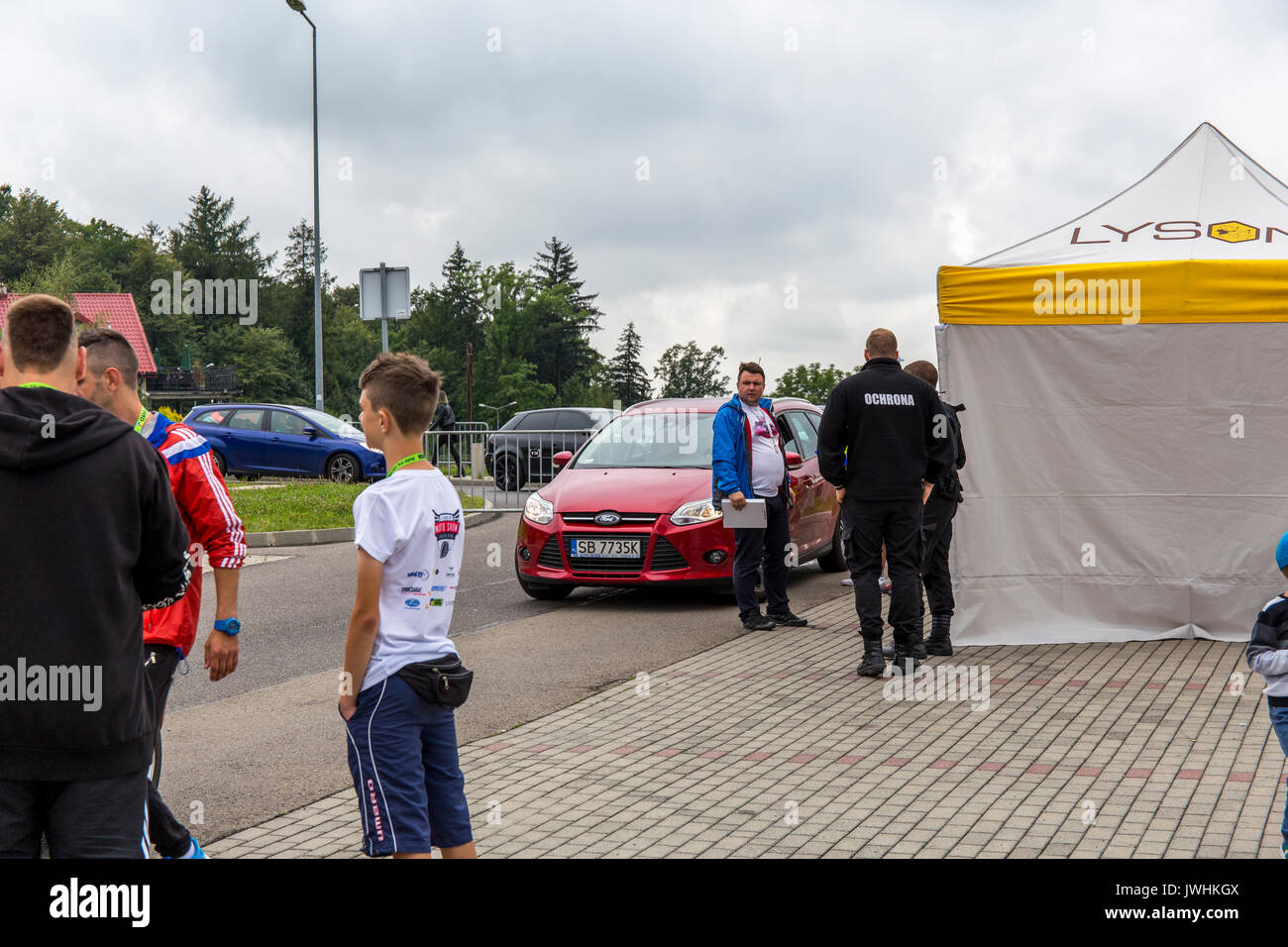 Bielsko-Biala, Poland. 12th Aug, 2017. International automotive trade fairs - MotoShow Bielsko-Biala. People standing at the entrance to the motoshow. Credit: Lukasz Obermann/Alamy Live News - Stock Image
