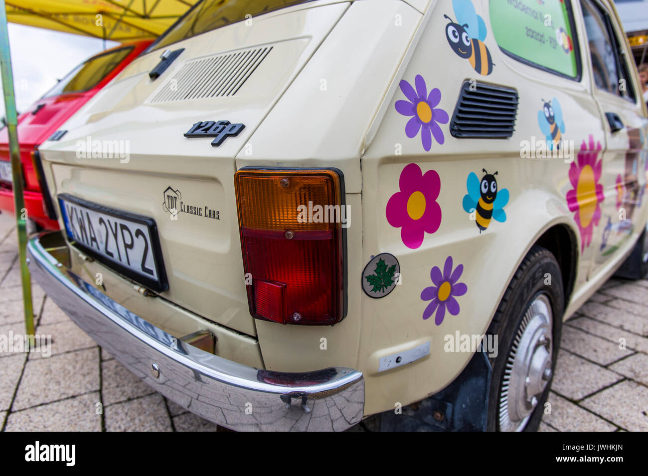 Bielsko-Biala, Poland. 12th Aug, 2017. International automotive trade fairs - MotoShow Bielsko-Biala. Rear of a Fiat 126p with bees and flowers paint. Credit: Lukasz Obermann/Alamy Live News - Stock Image
