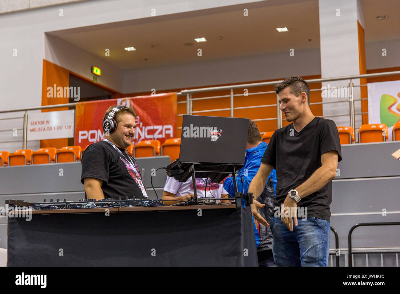 Bielsko-Biala, Poland. 12th Aug, 2017. International automotive trade fairs - MotoShow Bielsko-Biala. Man talking Stock Photo