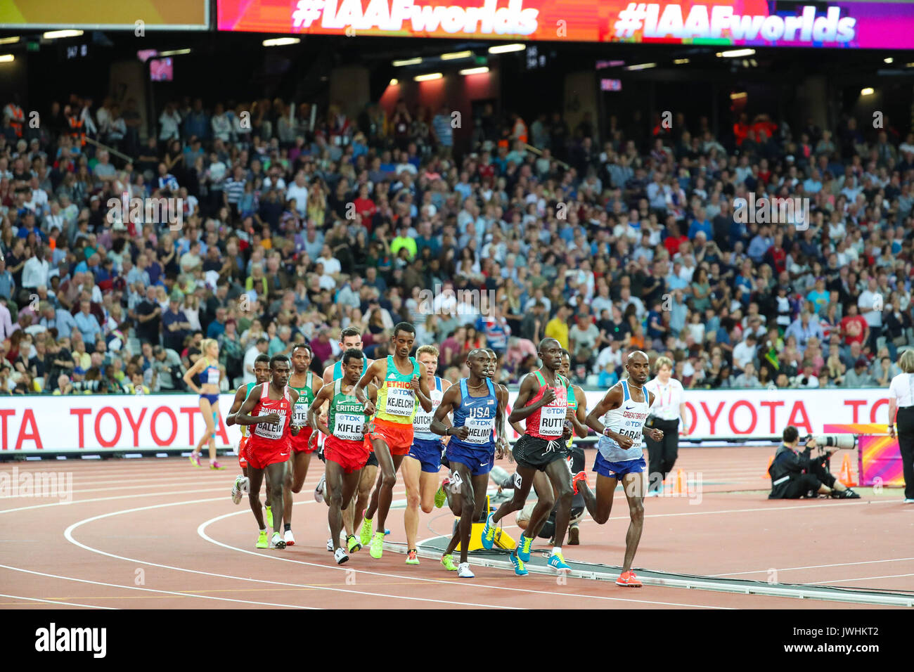 London, UK. 12th Aug, 2017.  Mo Farah, Great Britain, keeps an eye on a resurgent Cyrus Rutto, Kenya, in the men's 5000m final on day nine of the IAAF London 2017 world Championships at the London Stadium. Credit: Paul Davey/Alamy Live News - Stock Image
