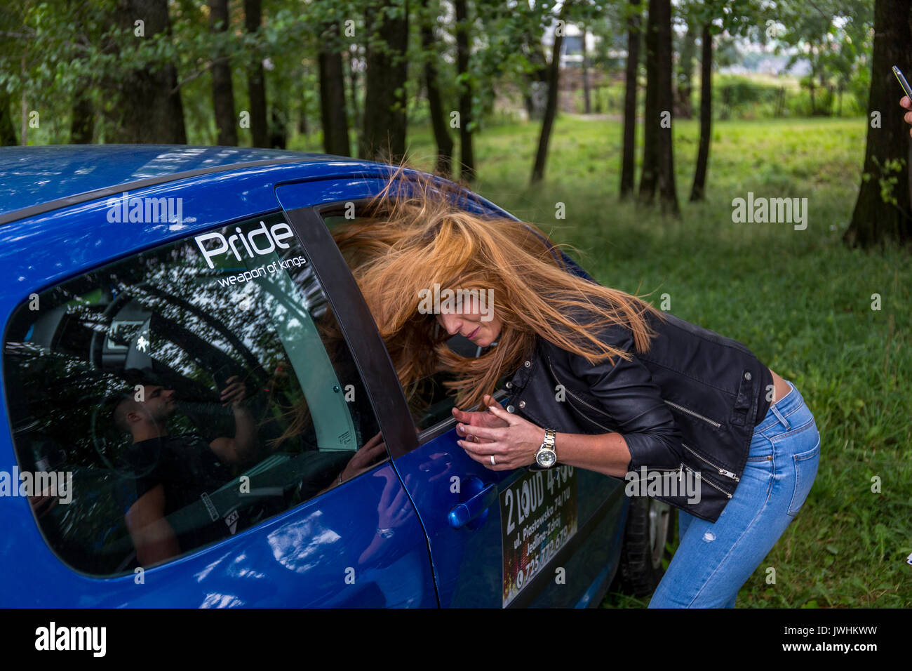 Bielsko-Biala, Poland. 12th Aug, 2017. International automotive trade fairs - MotoShow Bielsko-Biala. Woman's hair flying under the effect of car's bass. Credit: Lukasz Obermann/Alamy Live News - Stock Image