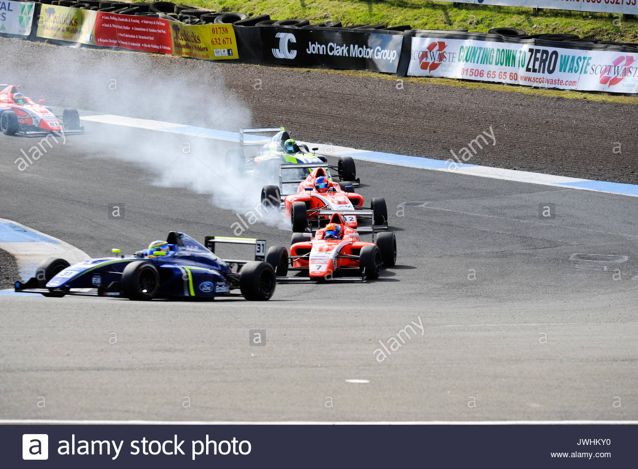 Dunfermline, UK. 13th Aug, 2017. Locking up into the Hairpin in a Formula 4 British Championship race during the Dunlop MSA British Touring Car Championship seventh round at Knockhill Race Circuit. Credit: Roger Gaisford/Alamy Live News - Stock Image