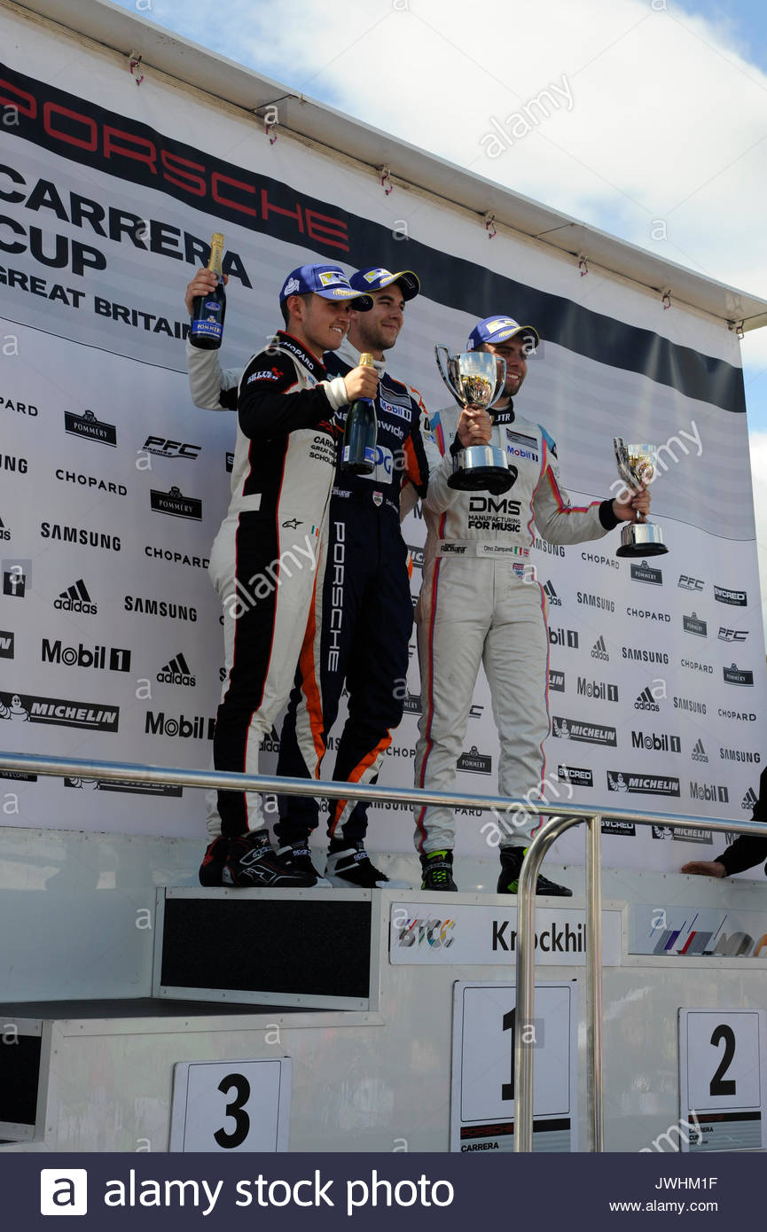 Dunfermline, UK. 13th Aug, 2017. Podium for the Pro drivers of the Porsche Carrera Cup GB L-R Charlie Eastwood 3rd, Dan Cammish 1st and Dino Zamparelli 2nd. During the Dunlop MSA British Touring Car Championship seventh round at Knockhill Race Circuit. Credit: Roger Gaisford/Alamy Live News - Stock Image
