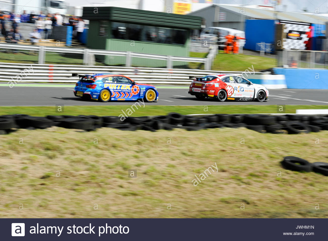 Dunfermline, UK. 13th Aug, 2017. (66) Josh Cook and Andrew Jordan (77) during the Dunlop MSA British Touring Car Championship seventh round at Knockhill Race Circuit. Credit: Roger Gaisford/Alamy Live News - Stock Image