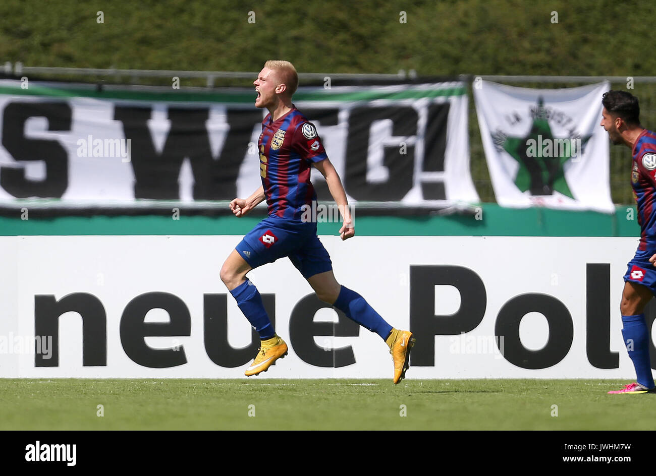 Bonn's Lars Lokotsch celebrates after giving his side a 1:0 lead during the German Soccer Association (DFB) Cup first-round match between Bonner SC and Hanover 96 in the Sportpark Nord Stadium in Bonn, Germany, 13 August 2017. (EMBARGO CONDITIONS - ATTENTION: The DFB prohibits the utilisation and publication of sequential pictures on the internet and other online media during the match (including half-time). ATTENTION: BLOCKING PERIOD! The DFB permits the further utilisation and publication of the pictures for mobile services (especially MMS) and for DVB-H and DMB only after the end of the - Stock Image