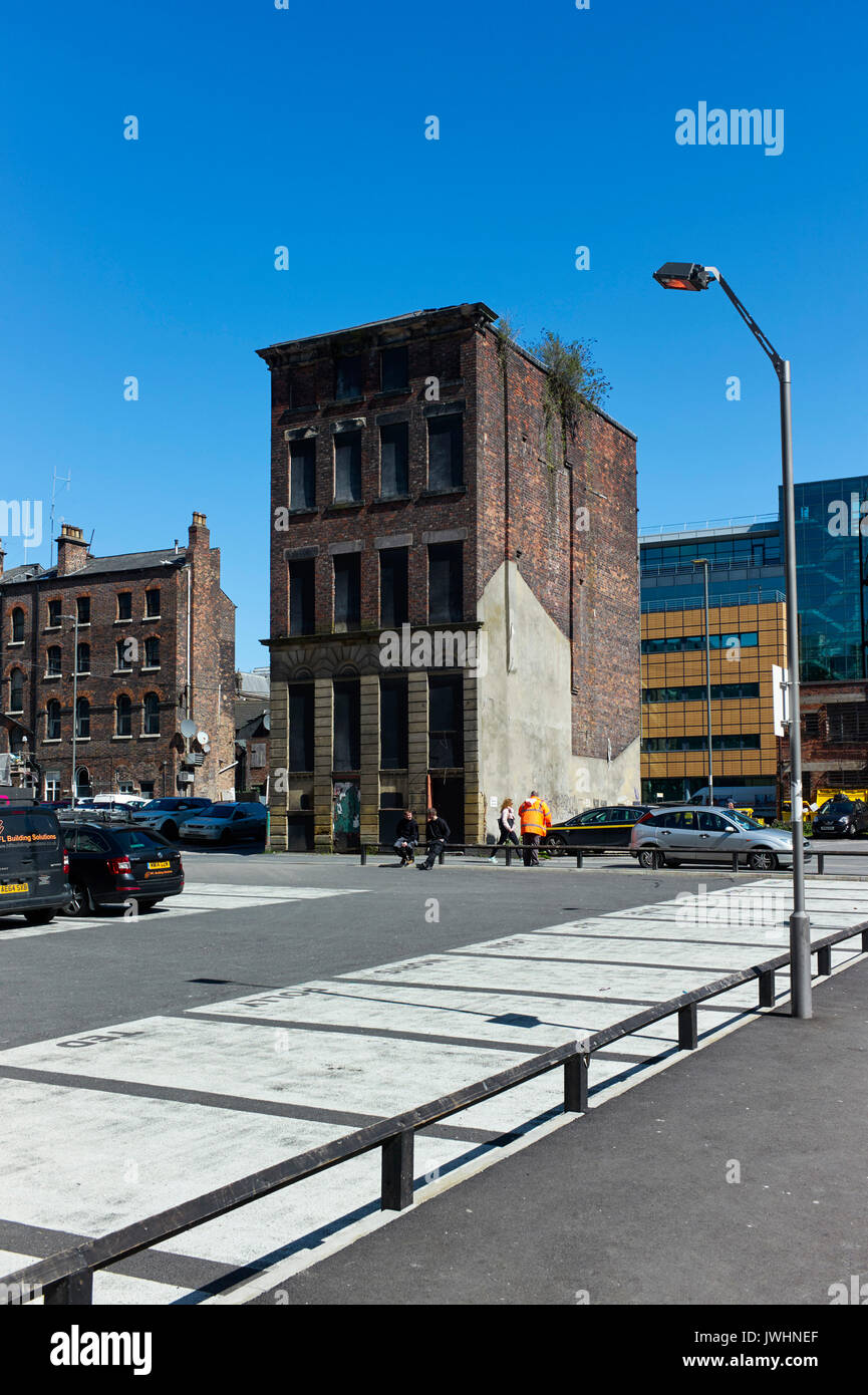Isolated older warehouse style building in Liverpool - Stock Image