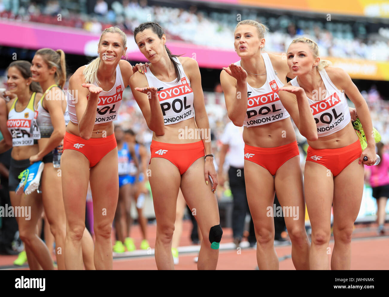 The Polish 4x400m Women's Relay Team Iga Baumgart, Martyna Dabrowska, Patrycja Wyciszkiewicz and Malgorzata Holub blow kisses to the crowd during day nine of the 2017 IAAF World Championships at the London Stadium. PRESS ASSOCIATION Photo. Picture date: Saturday August 12, 2017. See PA story ATHLETICS World. Photo credit should read: Adam Davy/PA Wire. RESTRICTIONS: Editorial use only. No transmission of sound or moving images and no video simulation. - Stock Image