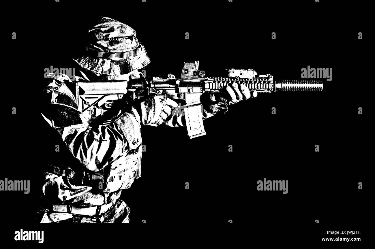 Bearded Special forces United States in Camouflage Uniforms studio shot half length black background, backlit. He is shooting killing enemy, pointing  - Stock Image