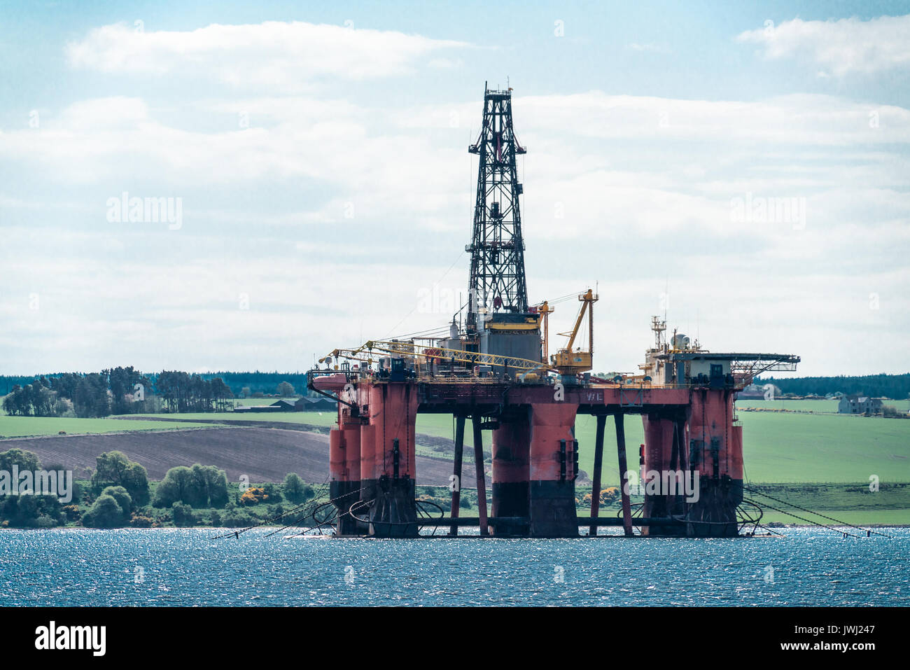 Disused North Sea oil drilling rig moored in the Cromarty Firth, Scotland Stock Photo