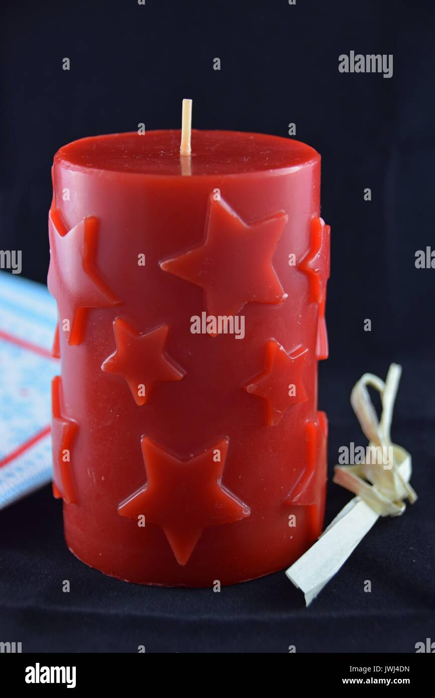 christmas candle with star pattern, tempus ante natale domini, Weihnachtskerze - Stock Image