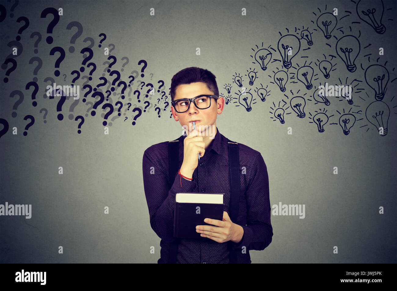 Man finding answers to many questions generating ideas - Stock Image