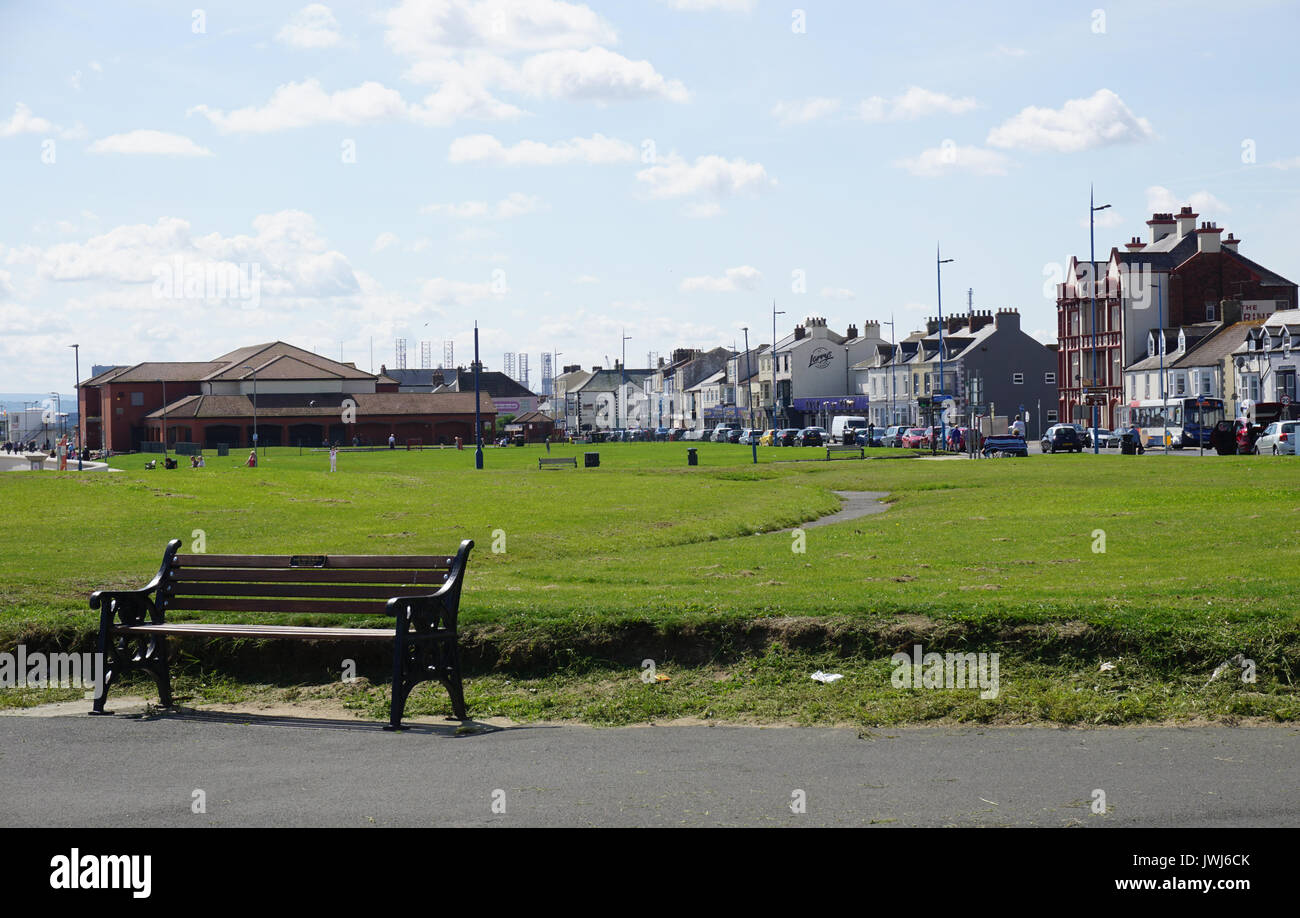 Seafront at Seaton Carew showing the  derelict Longscar Hall Building and the Marine Hotel - Stock Image