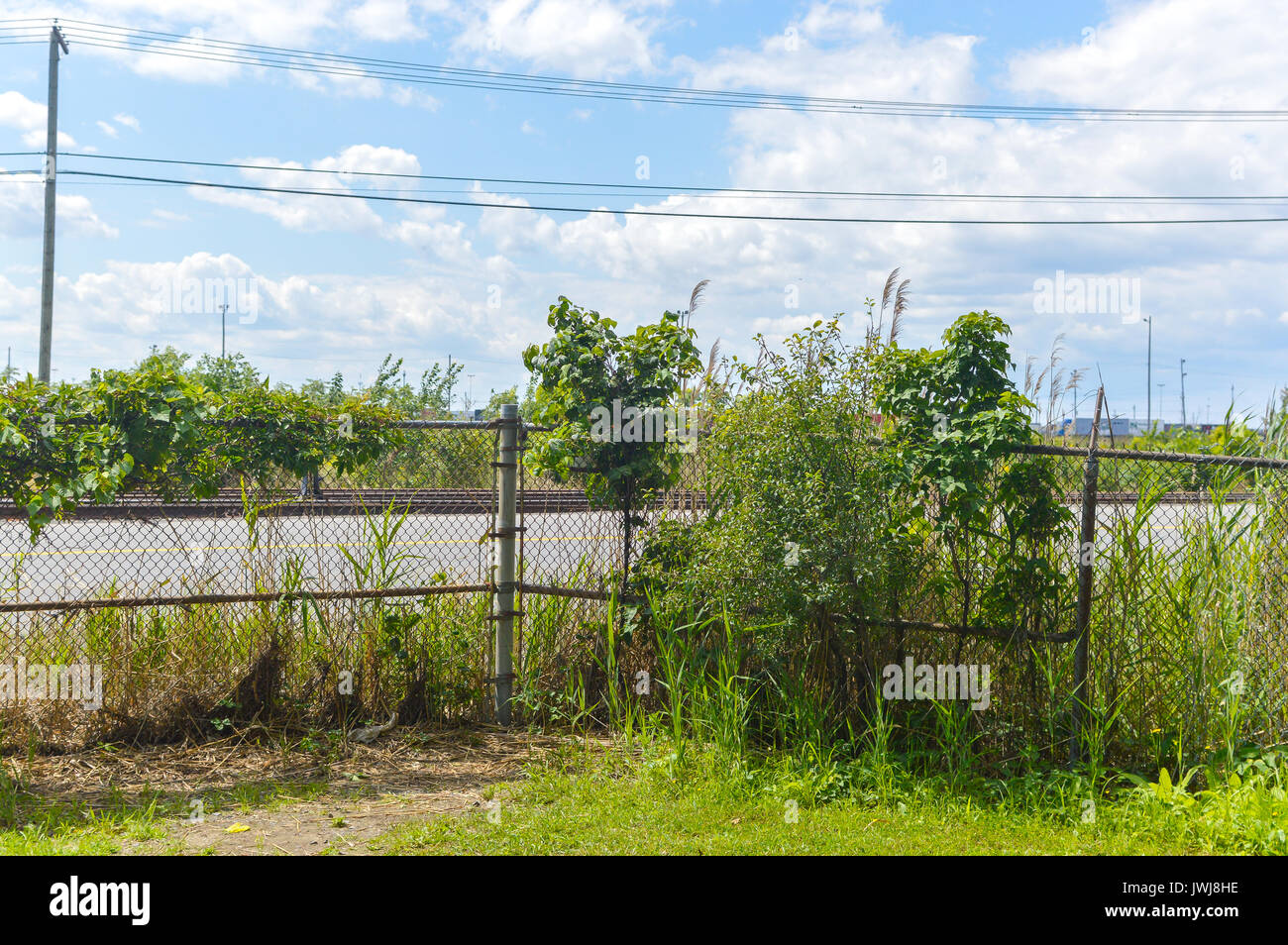 Rail road behind the fence in Cote Saint-Luc, Canada Stock Photo