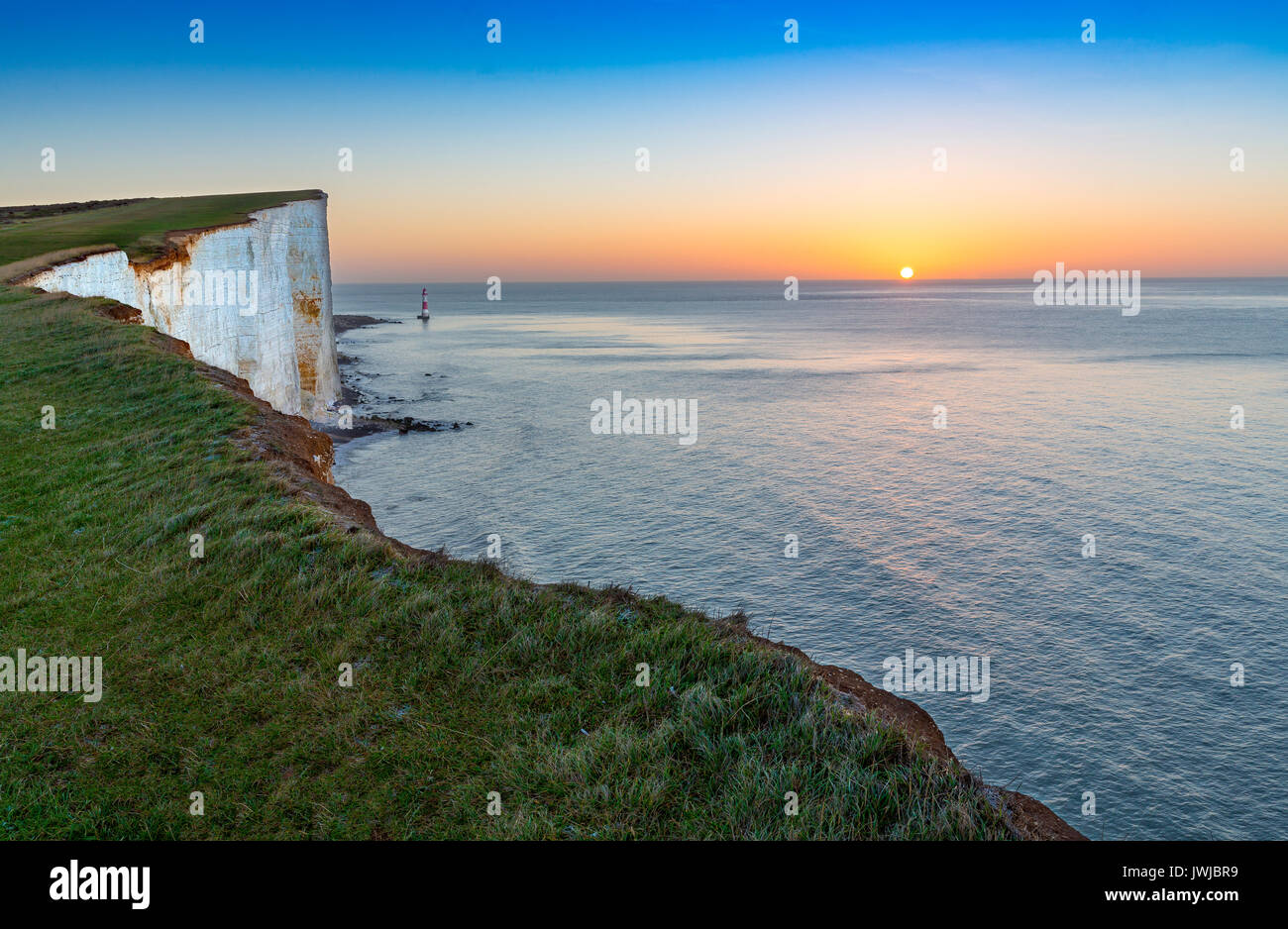 Beachy Head Light House and Chalk Cliffs at Sunrise, Sussex, England, UK - Stock Image