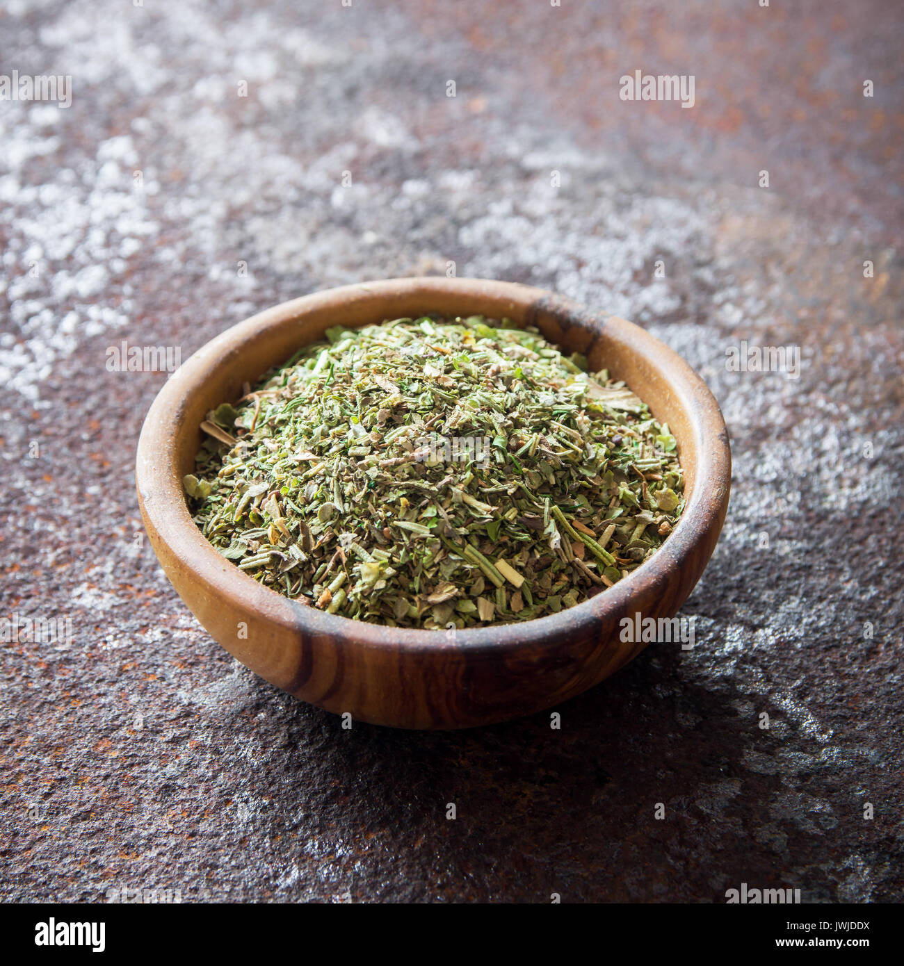 Mixed Italian Herbs Seasoning on rustic metal background, copy space. Dried Herbs Seasoning, healthy ingredient for cooking. - Stock Image