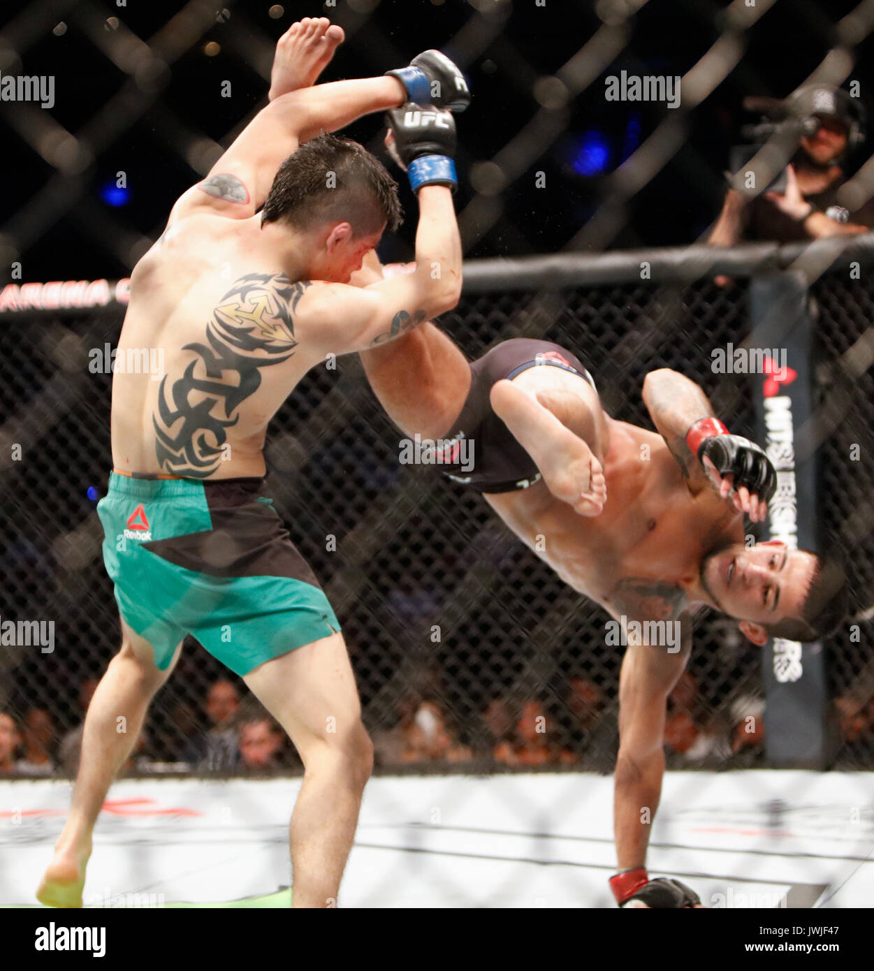 Brandon Moreno takes Sergio Pettis during UFC Fight Night 114 Mexico City,Mexico - Stock Image