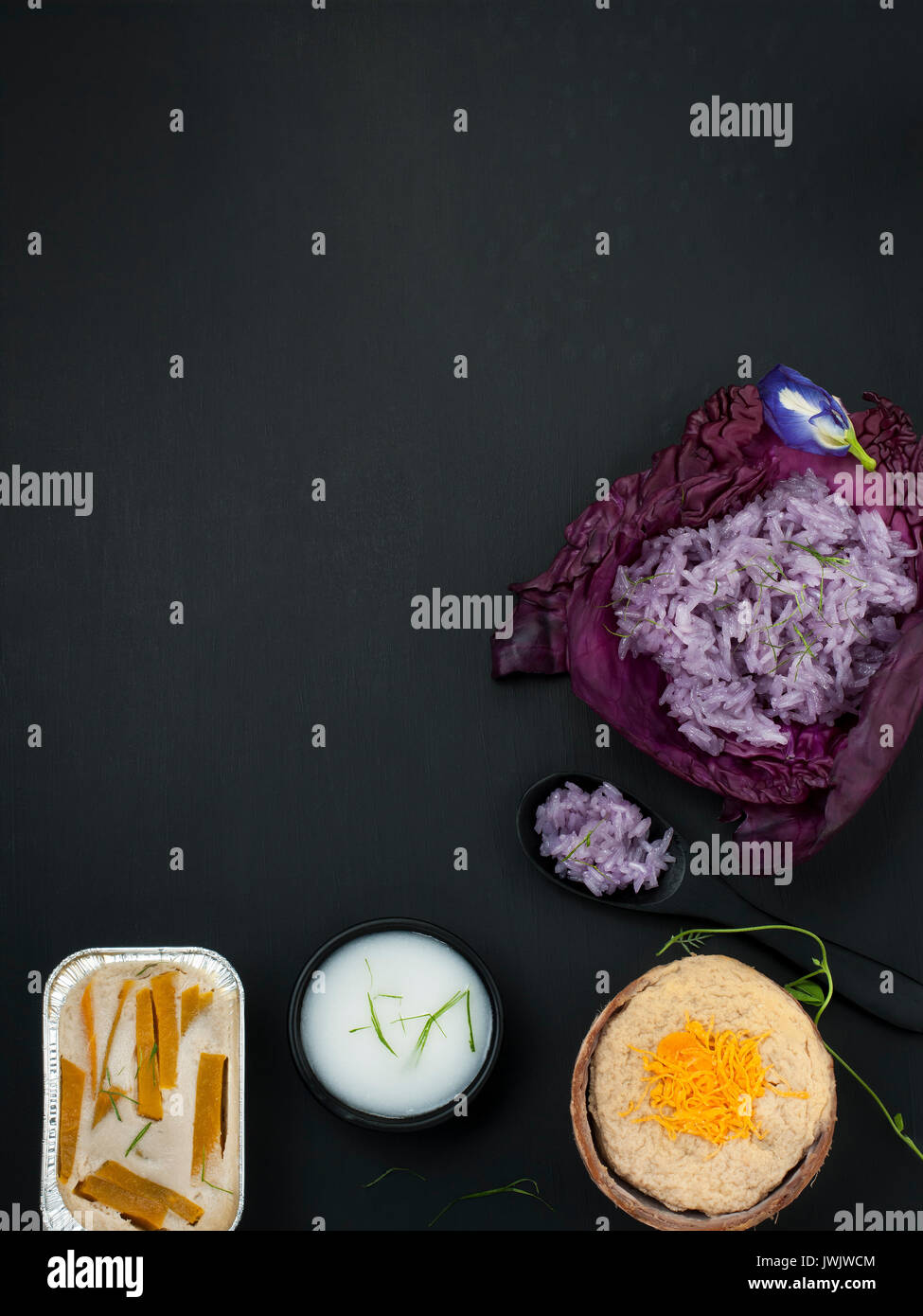 Blue pea sticky rice Thai custard with coconut milk thai dessert asian food styling - Stock Image