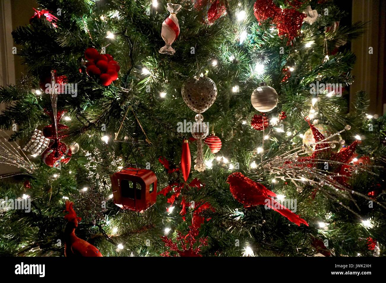 Close Up Of Red And Silver Christmas Tree Decorations On The Tree Stock Photo Alamy