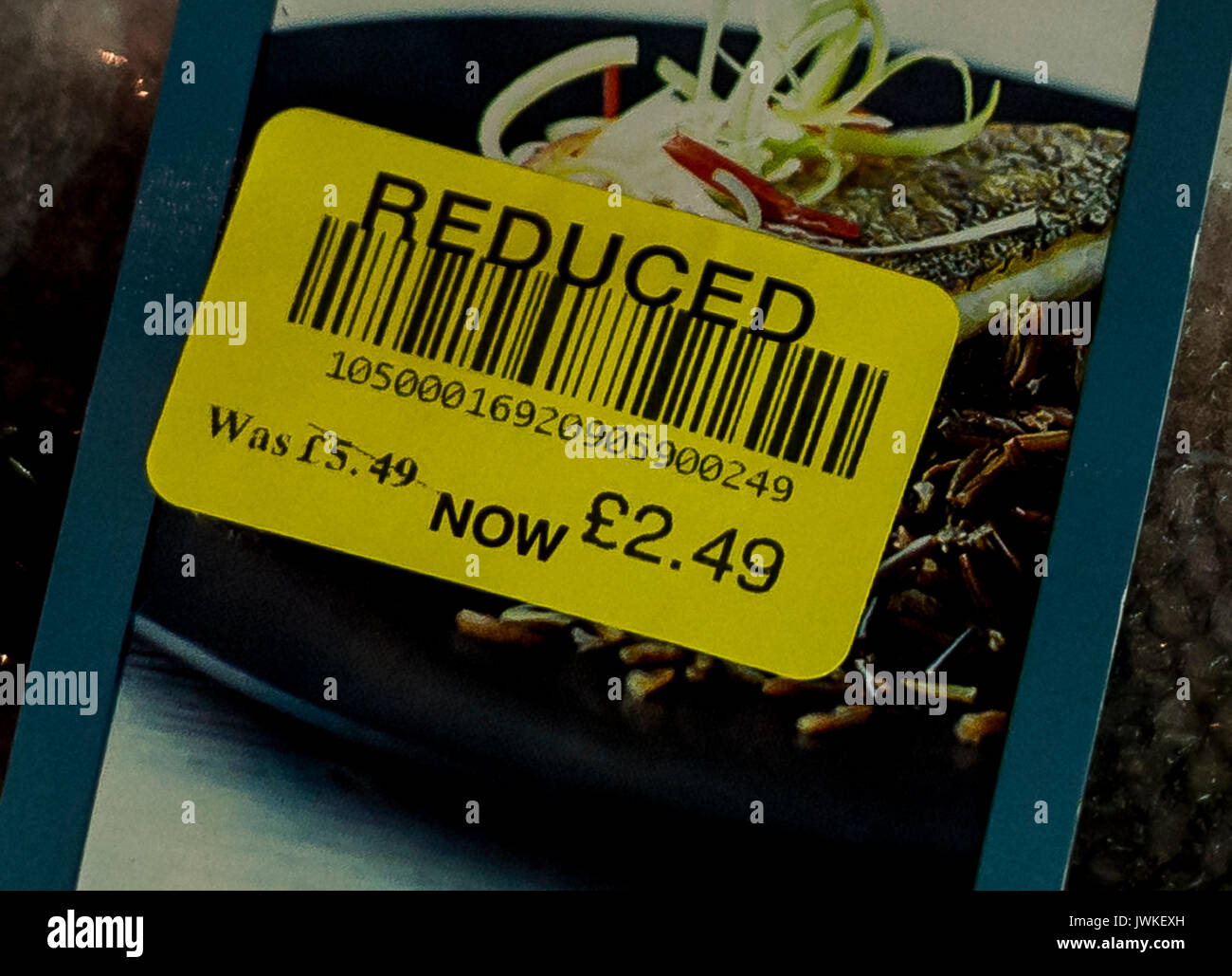 A price reduction sticker on a packet of food. - Stock Image