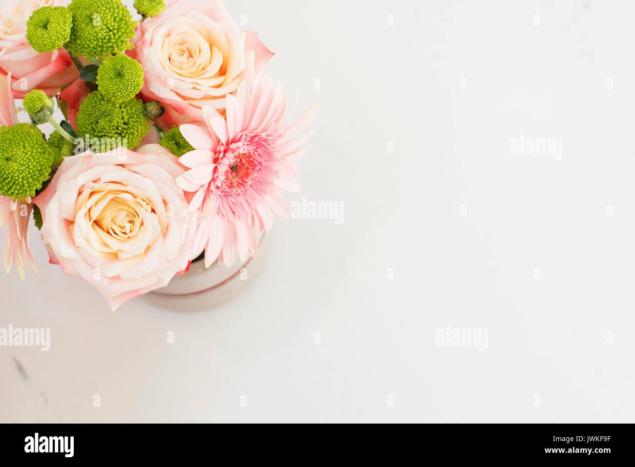 Beautiful fresh flowers on light marble table top view pink roses beautiful fresh flowers on light marble table top view pink roses and gerberas on a female work desk blogger lifestyle izmirmasajfo