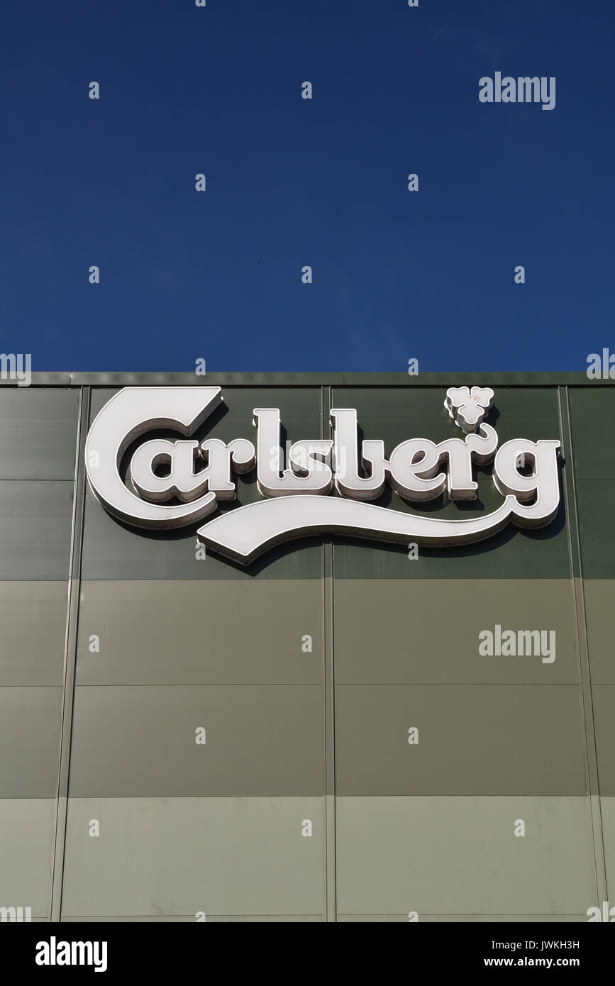 Carlsberg sign with blue sky background - Stock Image