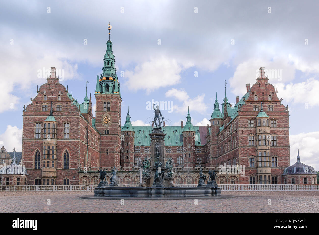 Neptune Fountain in front of Frederiksborg castle, the largest Renaissance residence in Scandinavia. Hillerod, Denmark, August 6, 2017 - Stock Image