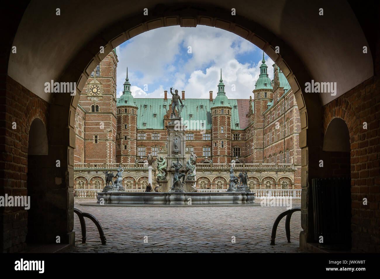 Entrance through the gate to Frederiksborg castle, the largest Renaissance residence in Scandinavia. Hillerod, Denmark, August 6, 2017 - Stock Image