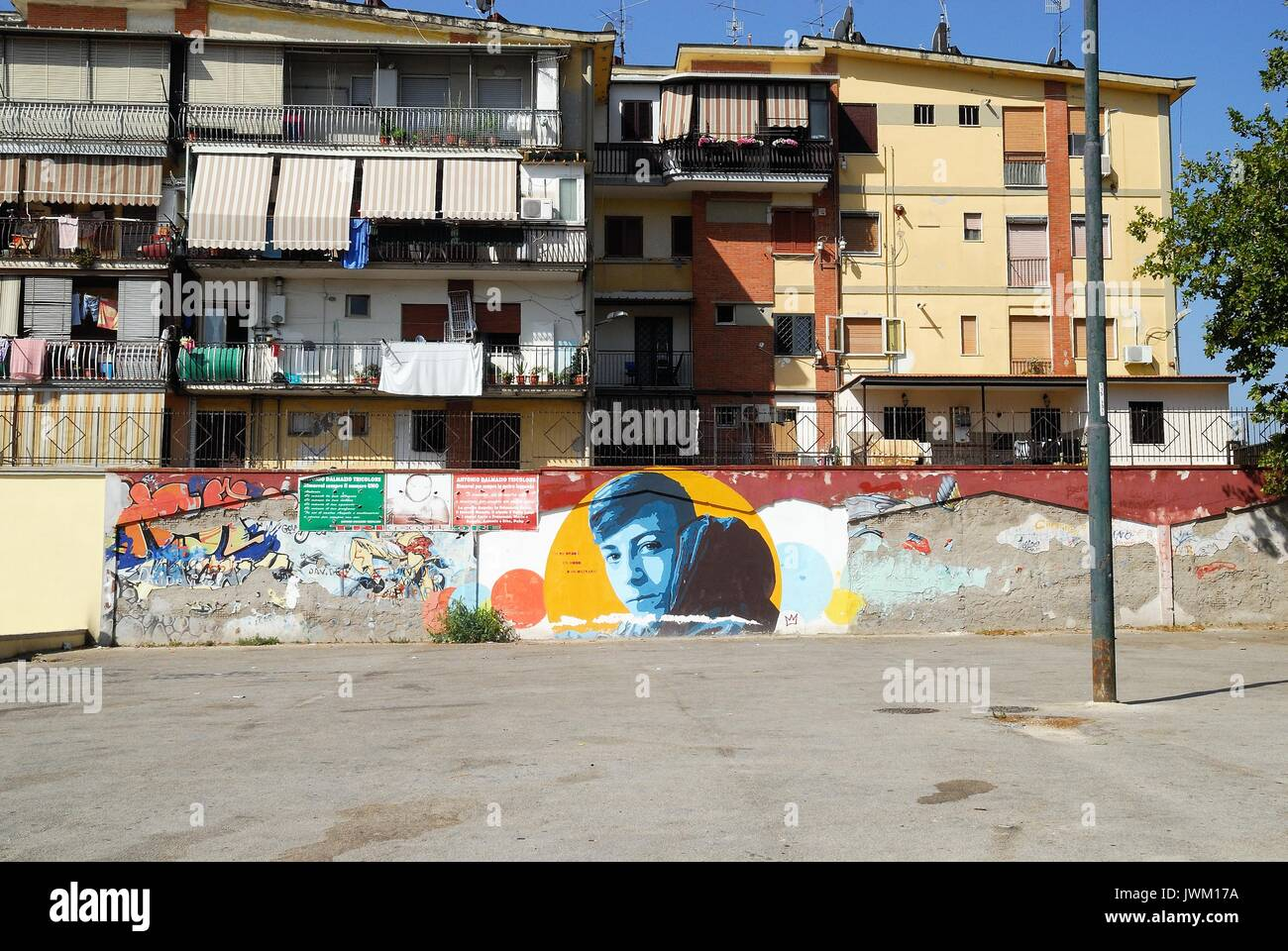 Naples, Italy. A mural on a wall of a degraded neighborhood called Rione Traiano. A mural represents Davide Bifolco, a boy killed by a carabiniere  because he did not stop at a roadblock with his scooter. - Stock Image