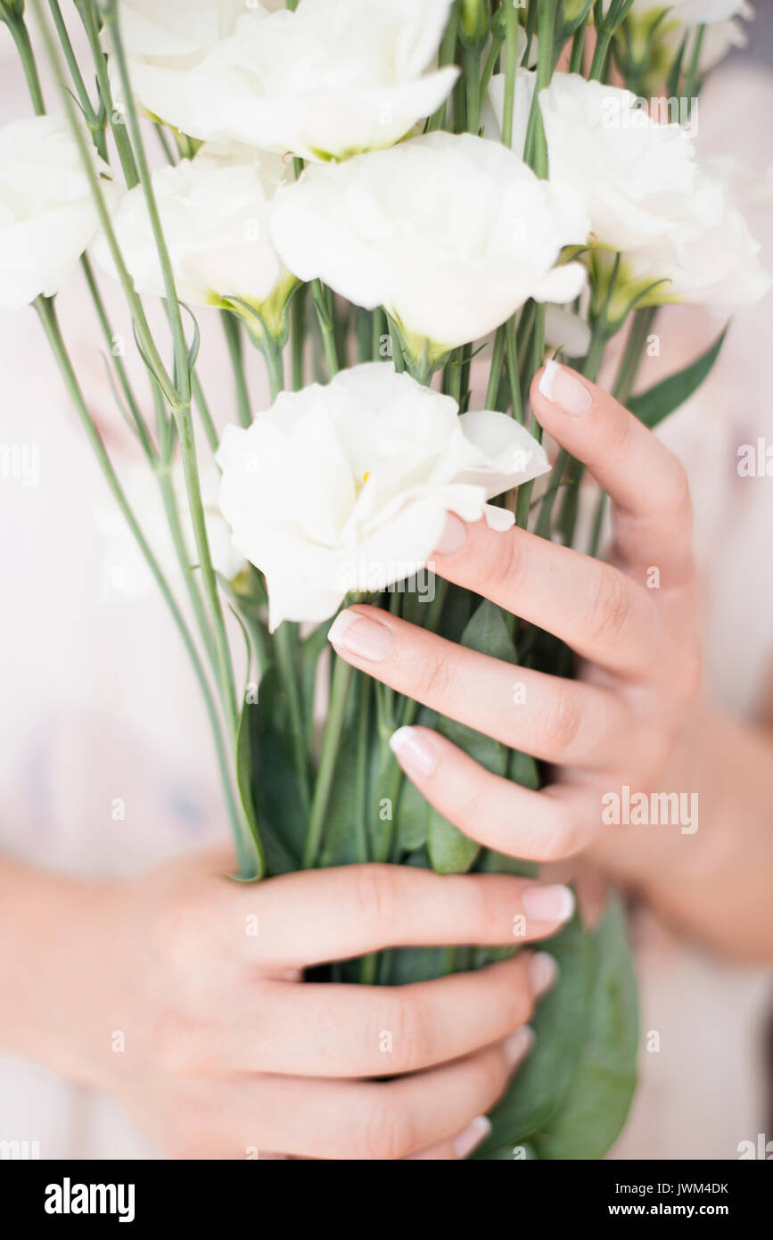 A young girl hand holding a large bouquet of fresh white flowers a young girl hand holding a large bouquet of fresh white flowers bright feminine lifestyle izmirmasajfo