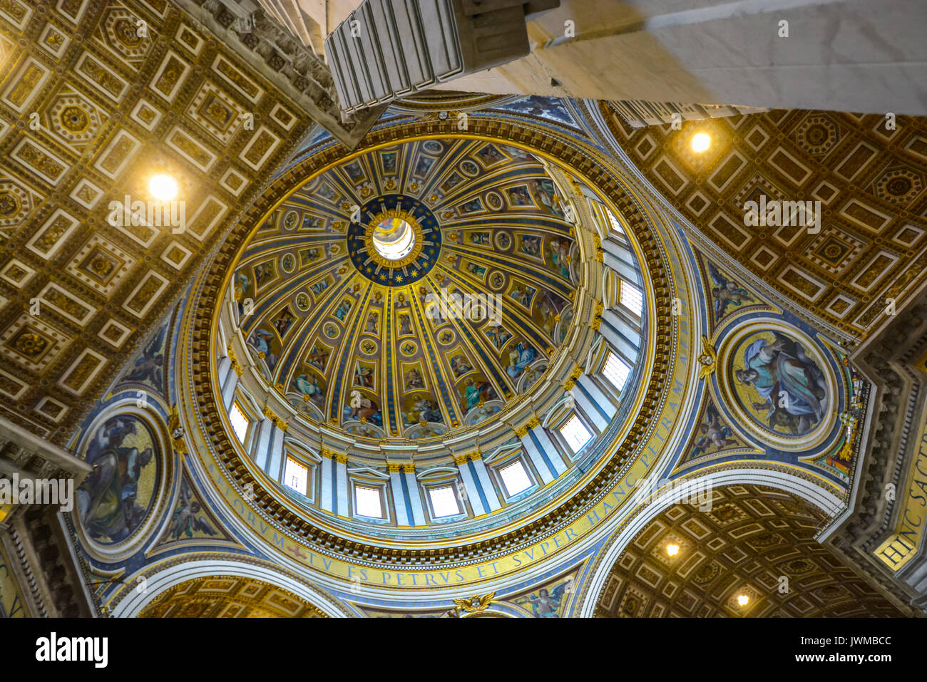 The Cupola of St Peters Basilica in Vatican City, Rome Italy from the interior showing brilliant gold and blue colors - Stock Image