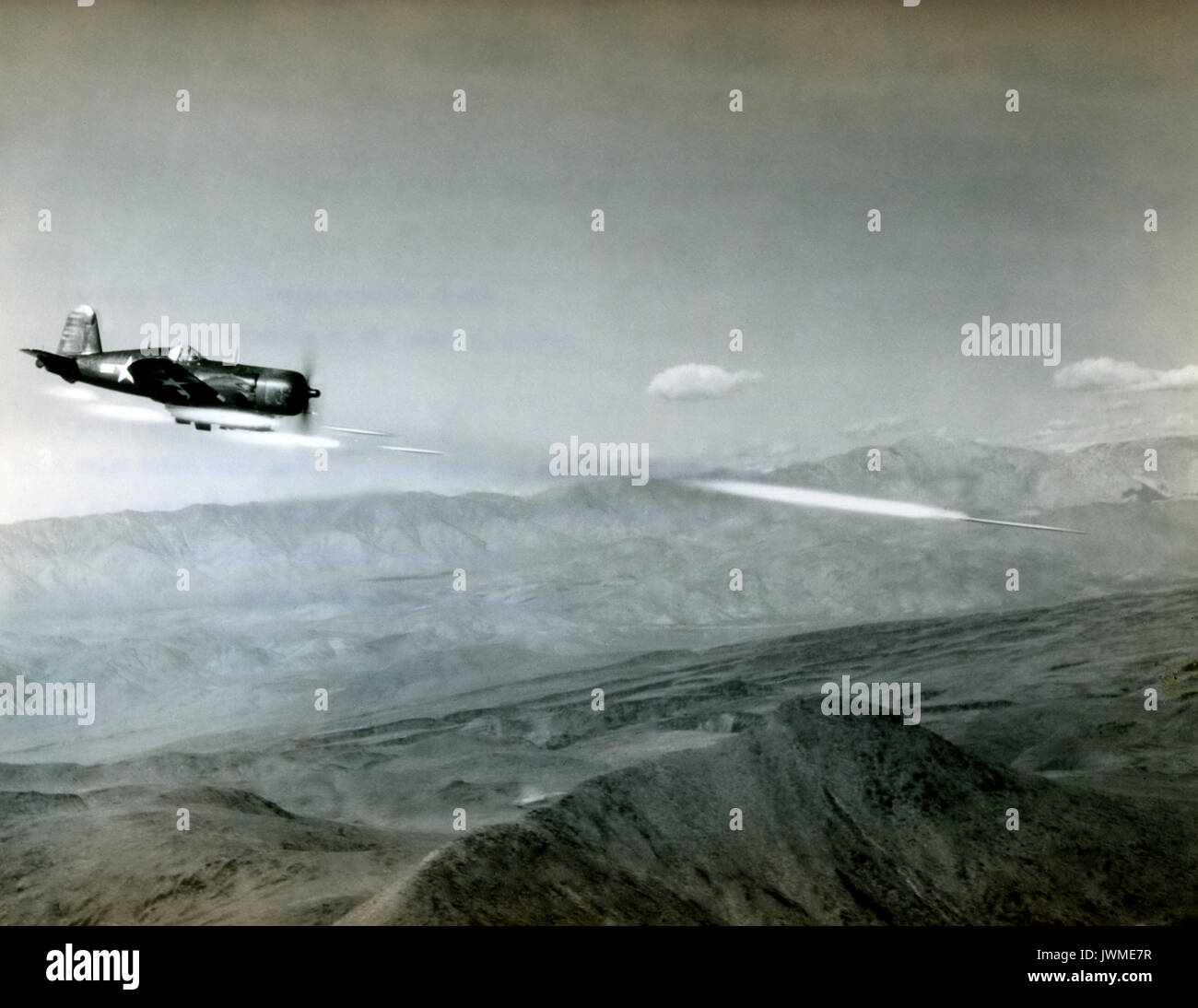 U.S. Navy Vought F4U Corsair fighter aircraft fires a 6.5-inch Anti-Tank Aircraft Rocket known as an ATAR during a combat mission over Korea during the Korean War in 1951. - Stock Image