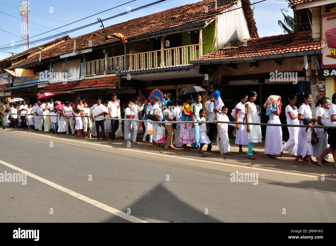 Queuing here to meet a revered religious person in this Sri Lankan town - Stock Image
