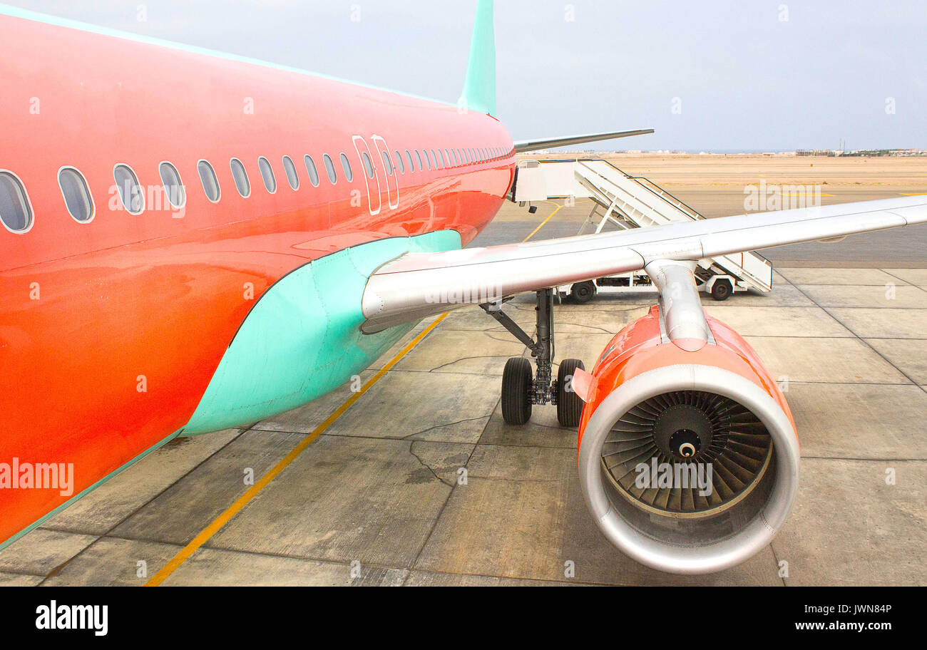 Airplane being preparing ready for takeoff in international airport - Stock Image