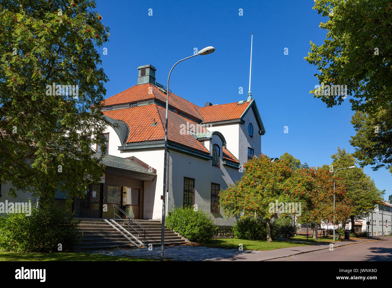 White stone buildng with red tiled roof. Hedemora, Sweden. - Stock Image