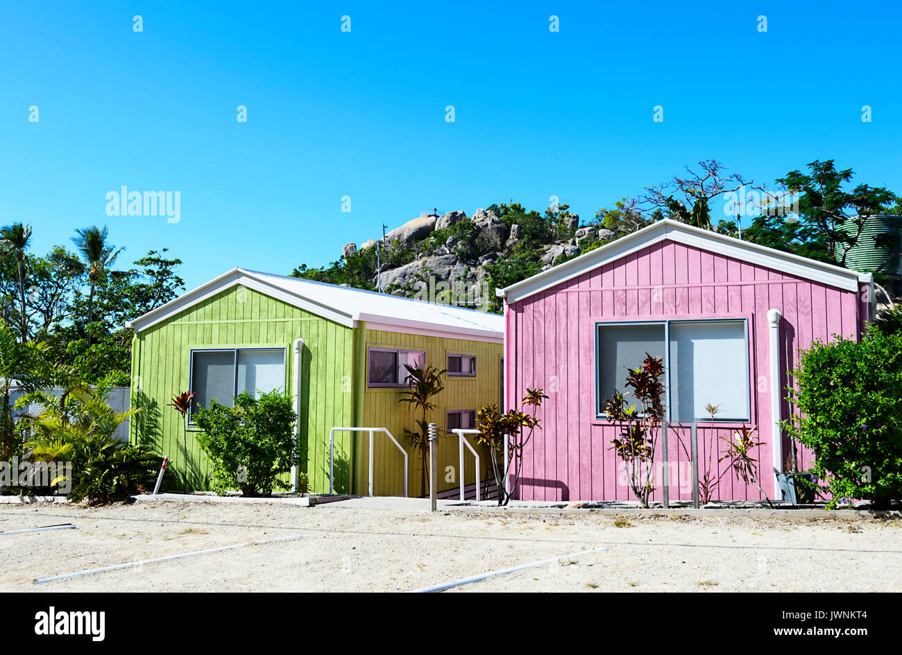 Row of pastel coloured cabins, Horseshoe Bay, Bowen, Queensland, QLD, Australia - Stock Image