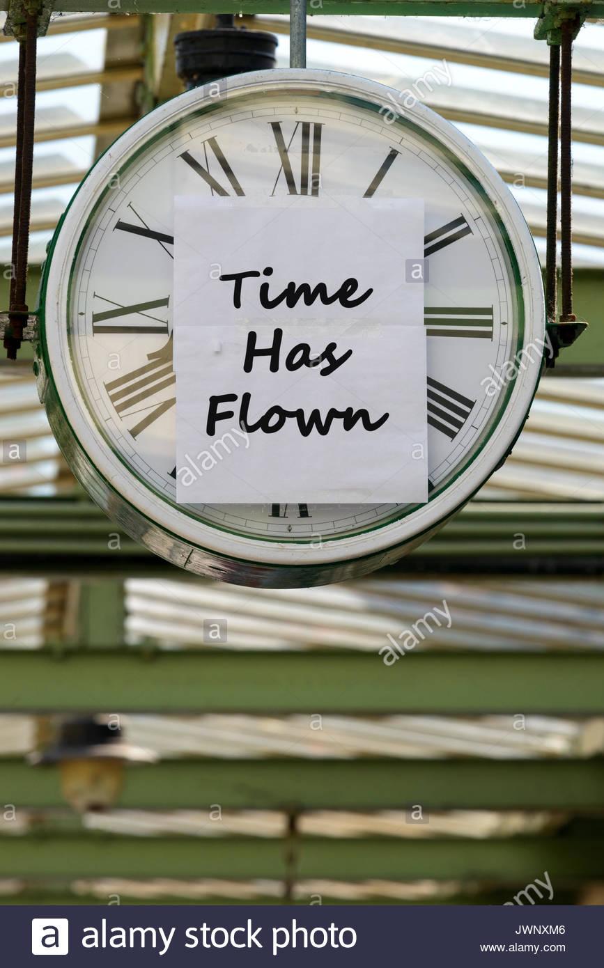 Time Has Flown, written on clock, Swanage, Dorset, England, UK - Stock Image