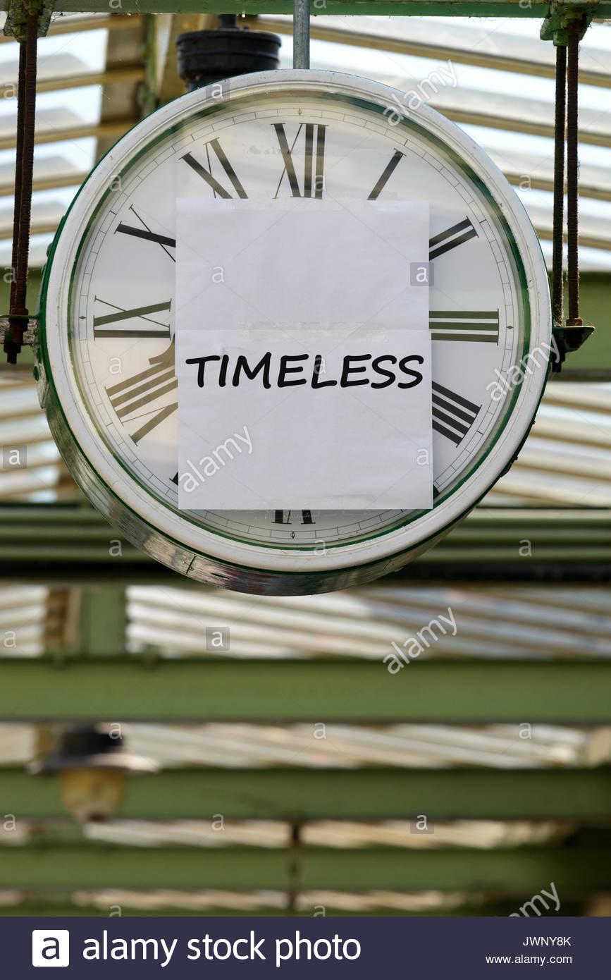 Timeless, written on clock, Swanage, Dorset, England, UK - Stock Image