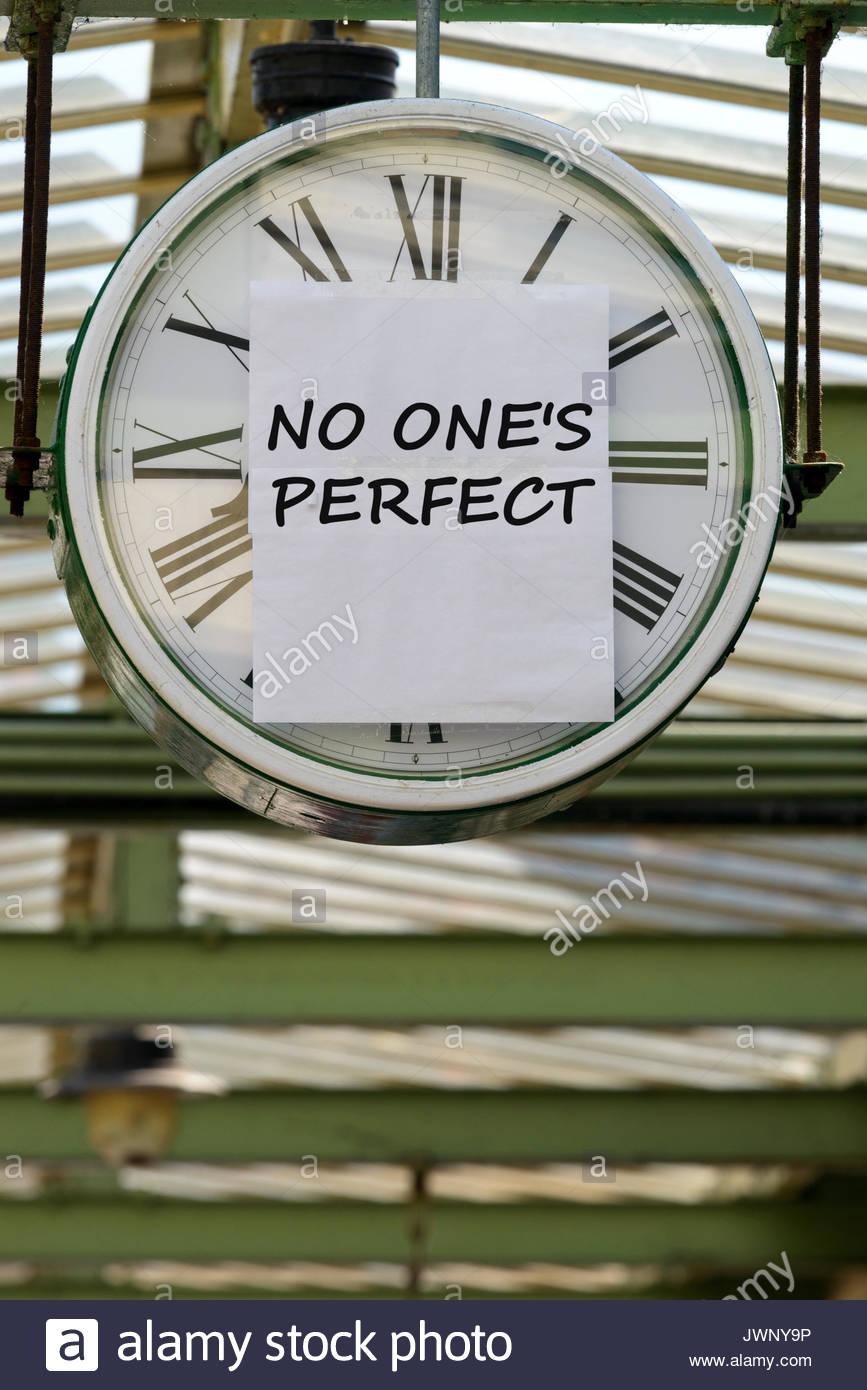 No One's Perfect, written on clock, Swanage, Dorset, England, UK - Stock Image