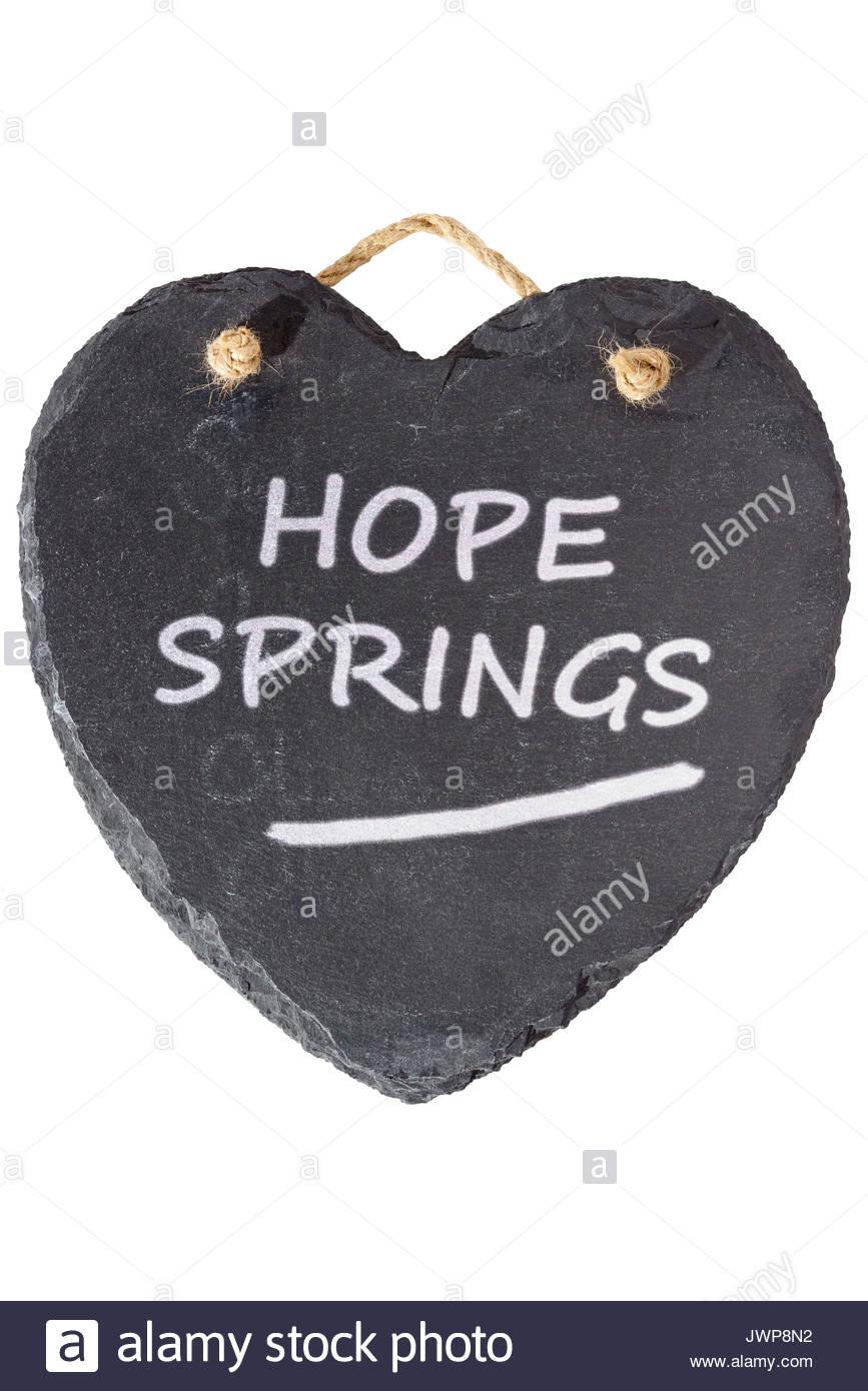 Hope springs written on a blackboard, Blandford, Dorset, England, UK - Stock Image
