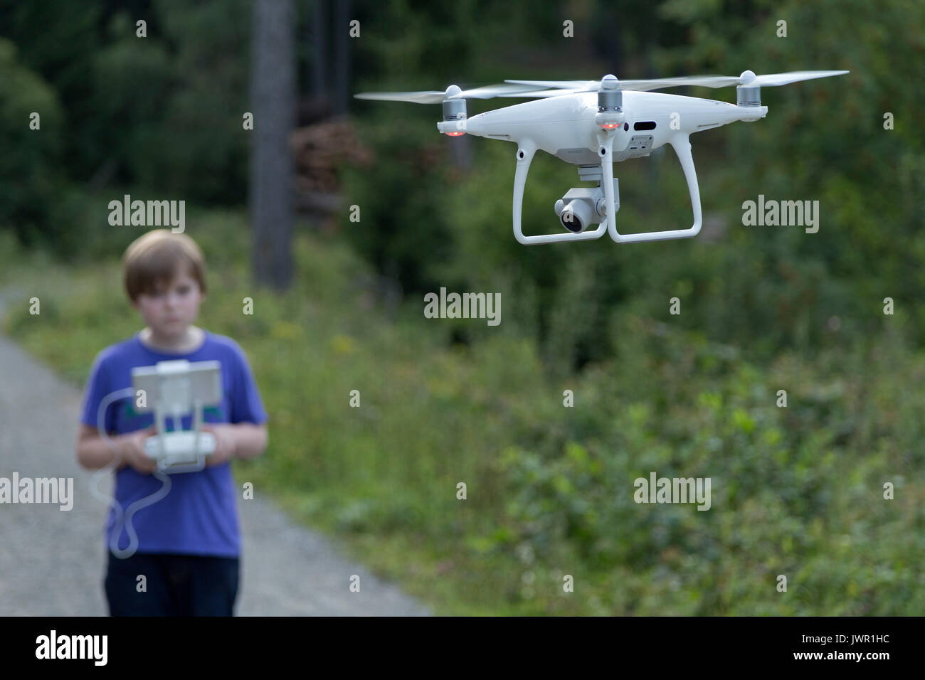 Young boy flying a drone - Stock Image