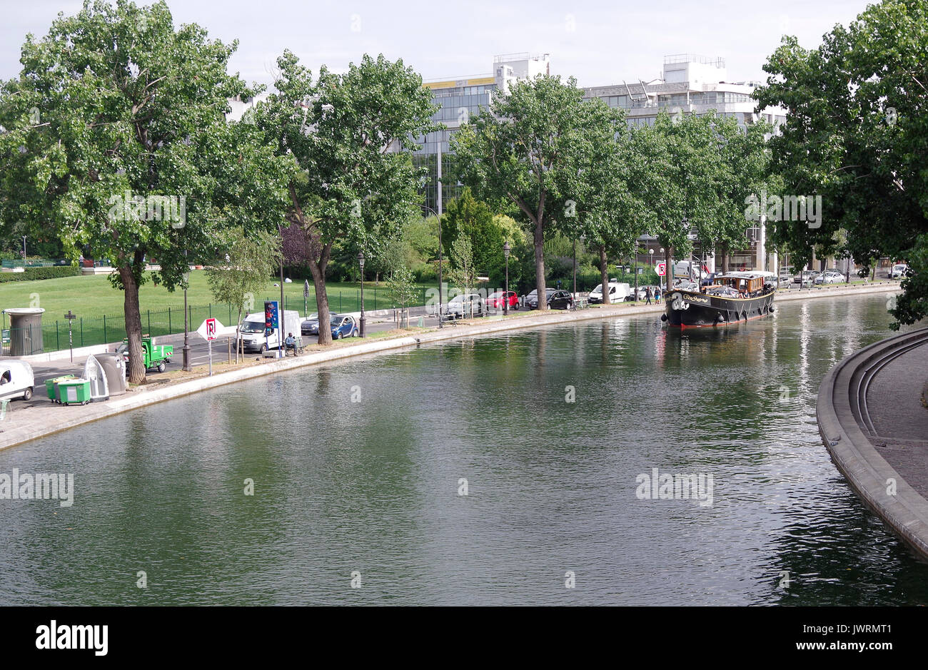 The MV Elizabeth, built for river and canal cruising, heading slowly south on the canal St Martin, Paris France - Stock Image