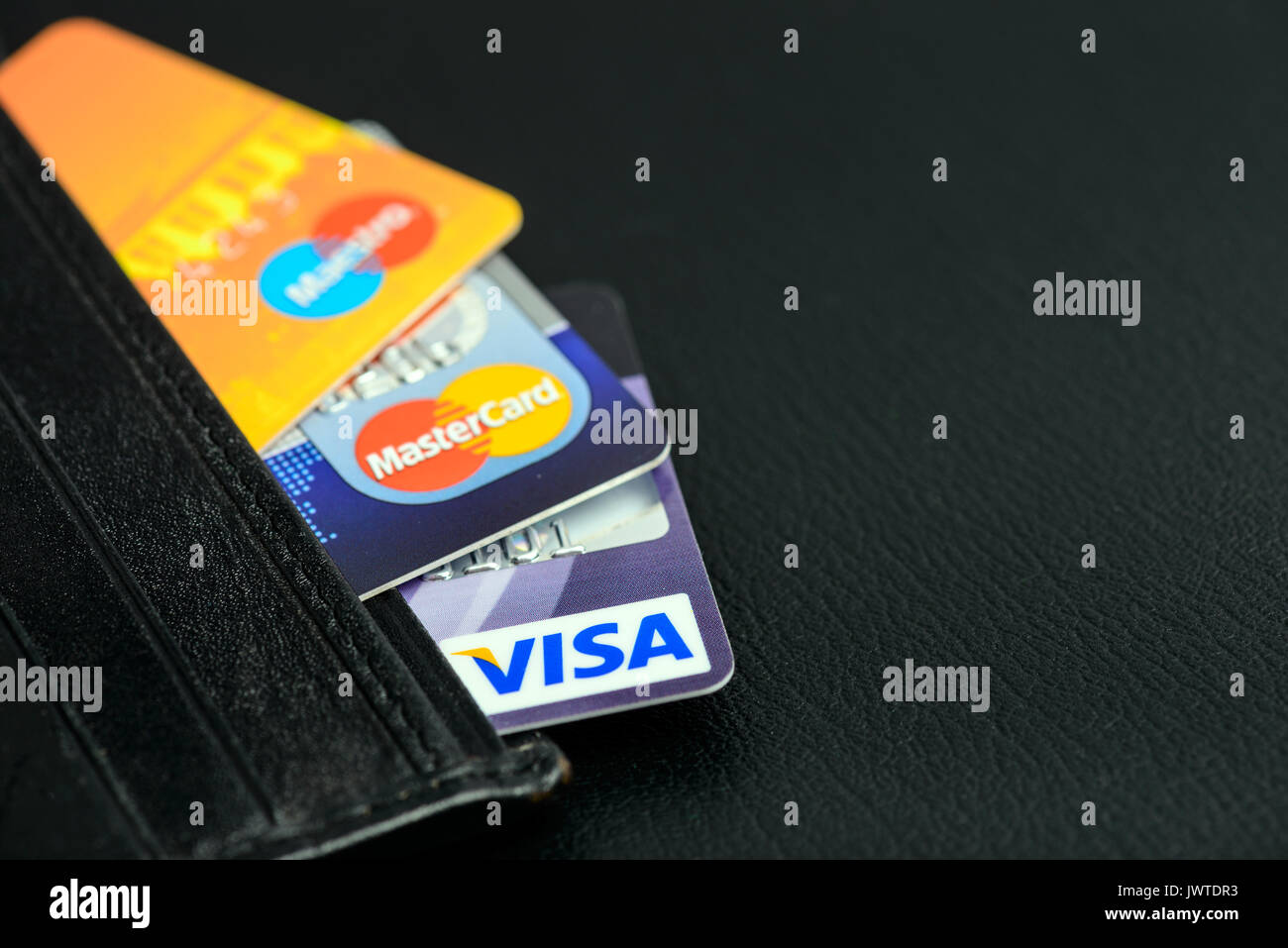 Moscowi, Russia - August 05, 2017: Visa and Mastercard credit cards in leather wallet - Stock Image