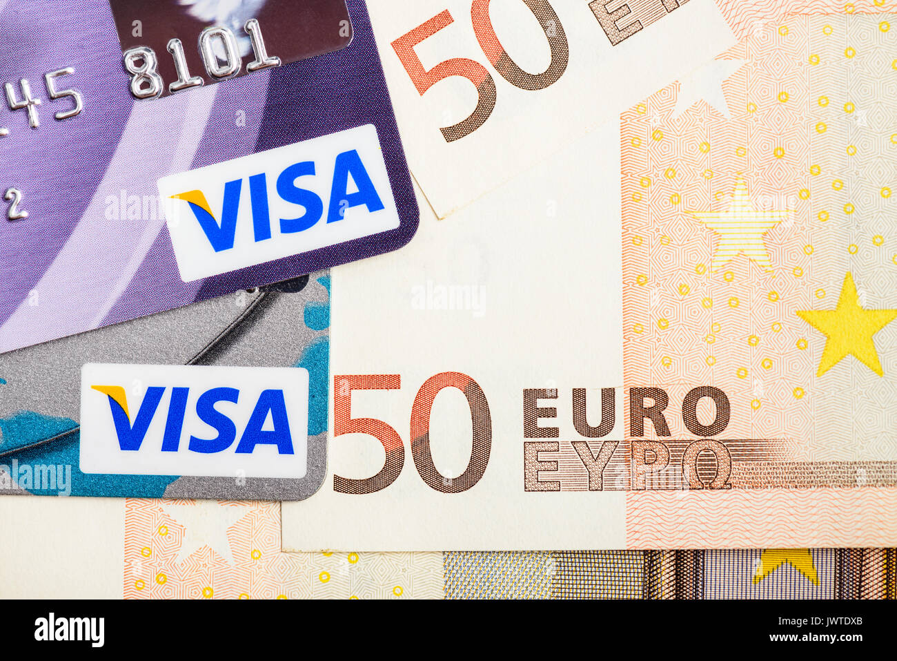 Moscowi, Russia - August 05, 2017: Visa credit cards over Euro currency banknotes - Stock Image