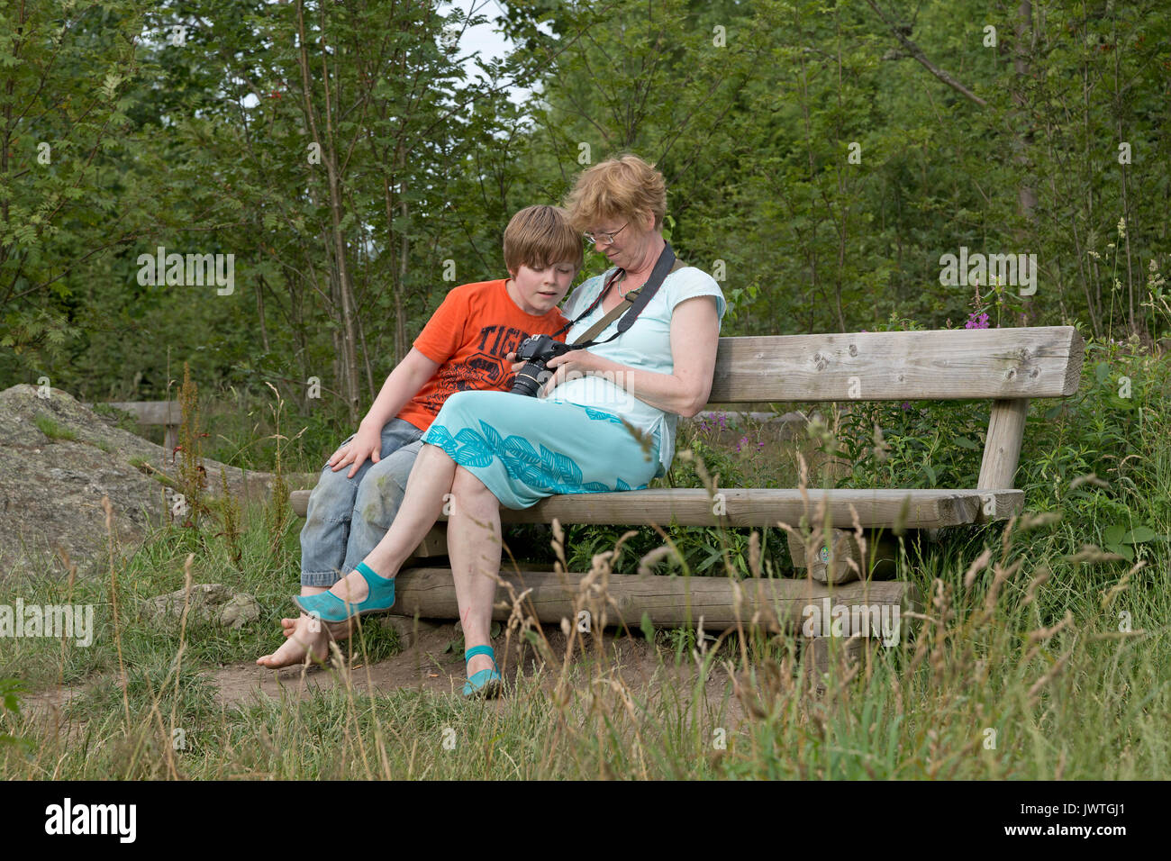 mother and son viewing their photos - Stock Image