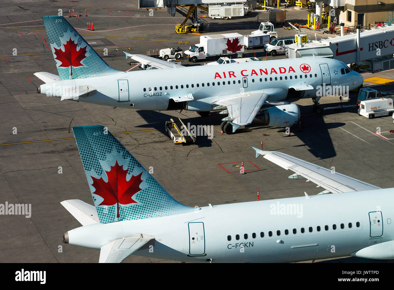 Air Canada Airline Airbus A321-211 and A319-114 Airliners C-FGKN and C-GAQZ on Stands at Calgary International Airport Alberta Canada - Stock Image