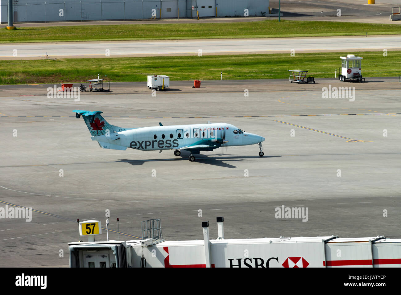 Air Canada Express Airline Beechcraft 1900D Airliner C-GAAU Taxiing at Calgary International Airport Alberta Canada - Stock Image