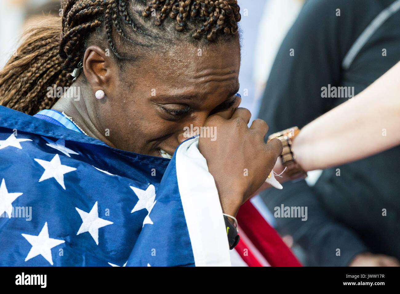 London, UK. 12th Aug, 2017.  an emotional Dawn Harper Nelson, USA, wipes here eyes after meeting her proud mother Linda at the side of the track following her silver medal in the women's 100m hurdles final on day nine of the IAAF London 2017 world Championships at the London Stadium. Credit: Paul Davey/Alamy Live News - Stock Image