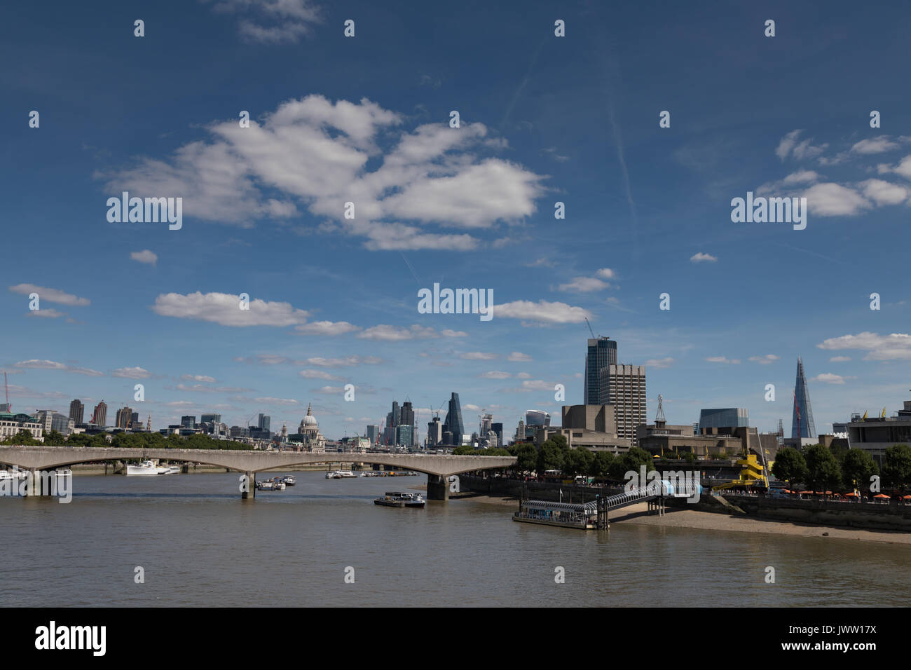River Thames, Embankment,London, UK. 13 August 2017. UK Weather: Warm sunny day with light cloud over London skyline. Stock Photo