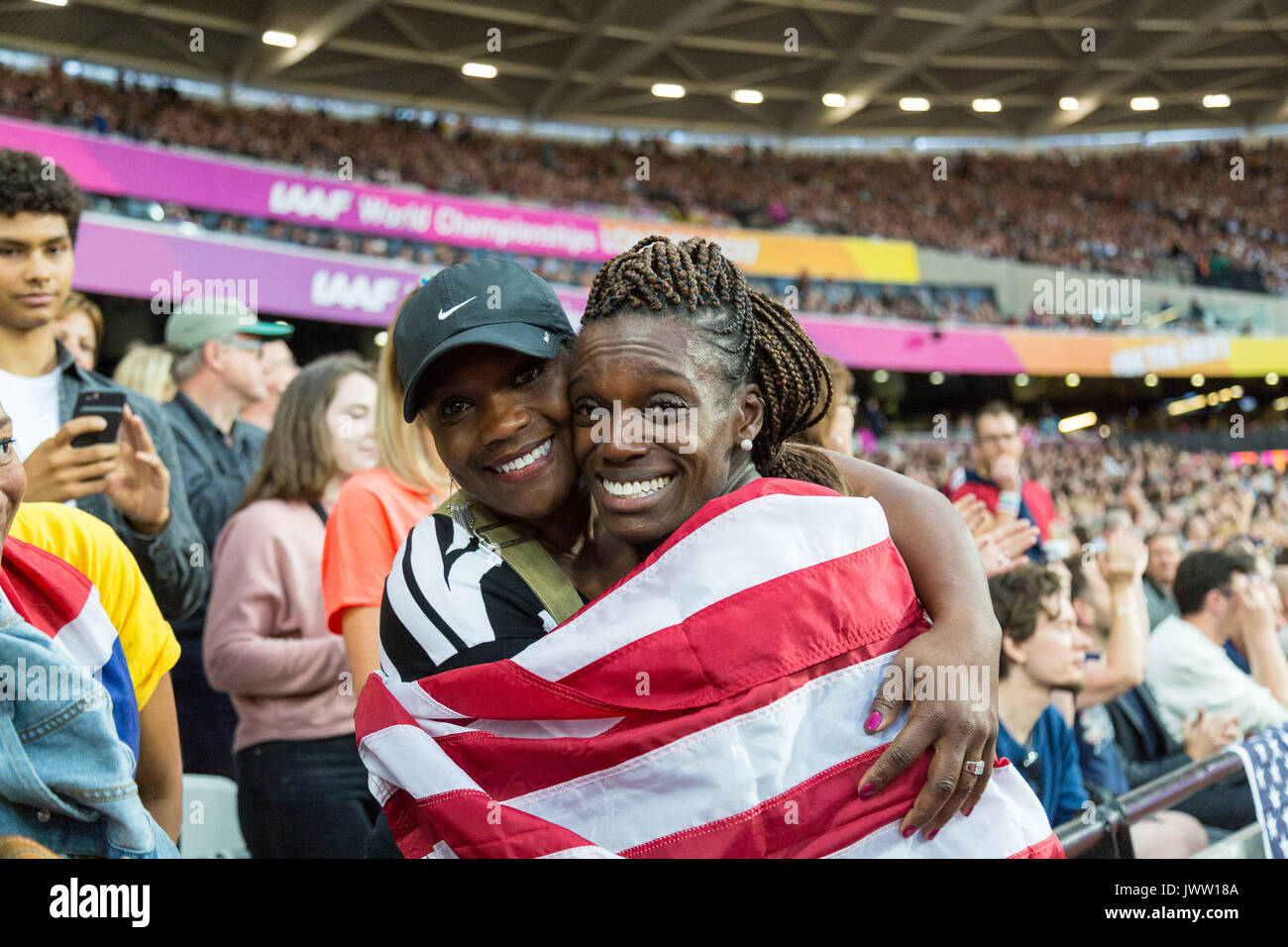 London, UK. 12th Aug, 2017.  Dawn Harper Nelson, USA, is embraced by her proud mother Linda following her silver medal in the women's 100m hurdles final on day nine of the IAAF London 2017 world Championships at the London Stadium. Credit: Paul Davey/Alamy Live News - Stock Image