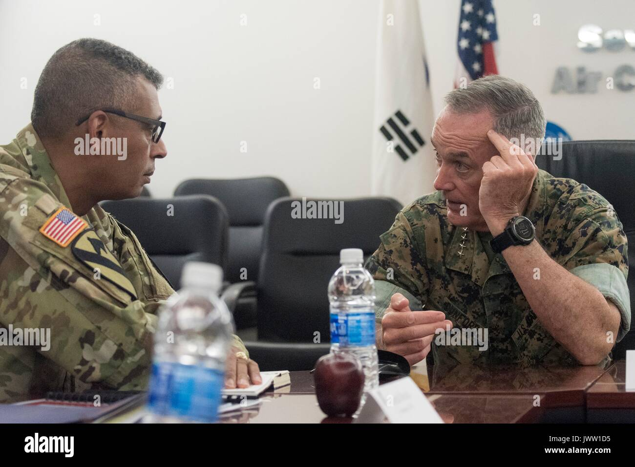 U.S. Chairman of the Joint Chiefs Gen. Joseph Dunford, right, meets with Army Gen. Vincent Brooks, commander, U.S. Forces Korea, at Osan Air Base August 13, 2017 in Pyeongtaek, Gyeonggi-do, South Korea. Dunford is meeting military leaders in the Asia-Pacific region as tensions rise with North Korea over nuclear and ballistic missiles tests. - Stock Image